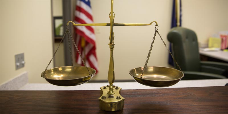 Scales of justice sitting on court table